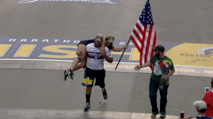 A wounded veteran  carried  his running partner Across Marathon Finish Line