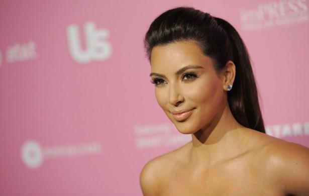 Bra-free Kim Kardashian met friend Jonathan Cheban for lunch at Chin Chin in the Studio City neighborhood of Los Angeles. Photo