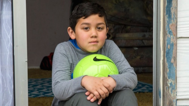 Little Boy Won't Let Go of Police Gift After They Replace Stolen Ball