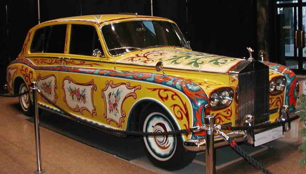 John Lennon's psychedelic Rolls-Royce returns to Britain to mark the launch of its new Phantom and 50 years of Sgt Peppers