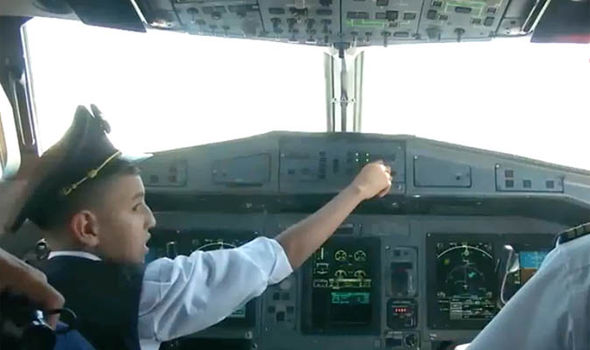 Airline pilots suspended after letting CHILD sit in Captain's chair and fly plane