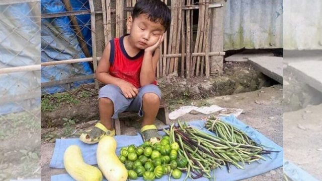 Photo of boy dozing off at improvised vegetable store goes viral, Filipino megastar calls for action