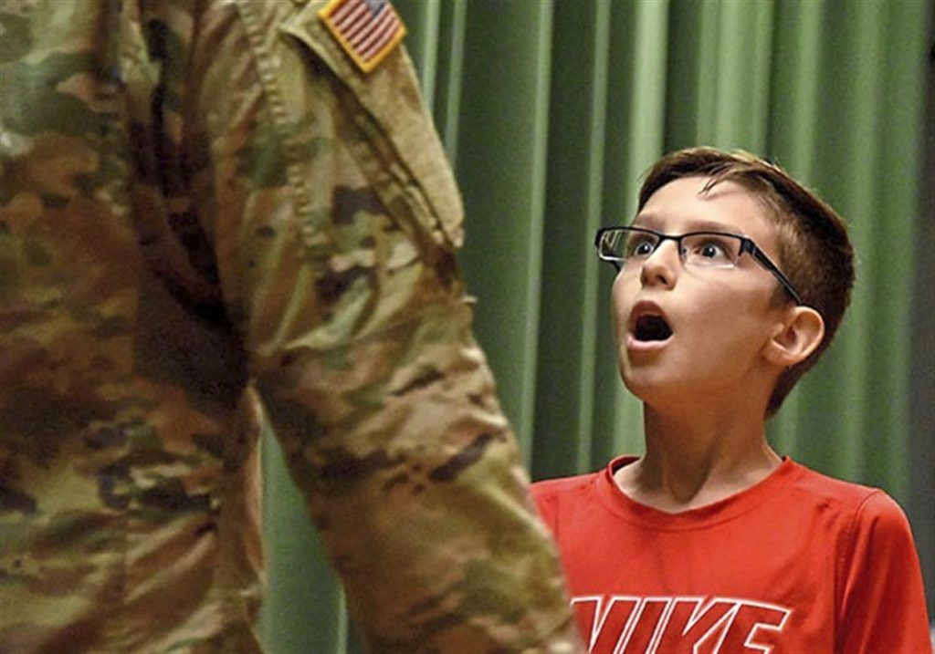 6th grader explodes when Soldier brother surprises him after 2 years apart