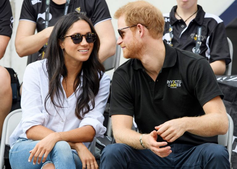 Prince Harry and Meghan Markle share first public kiss during Invictus Games closing ceremony