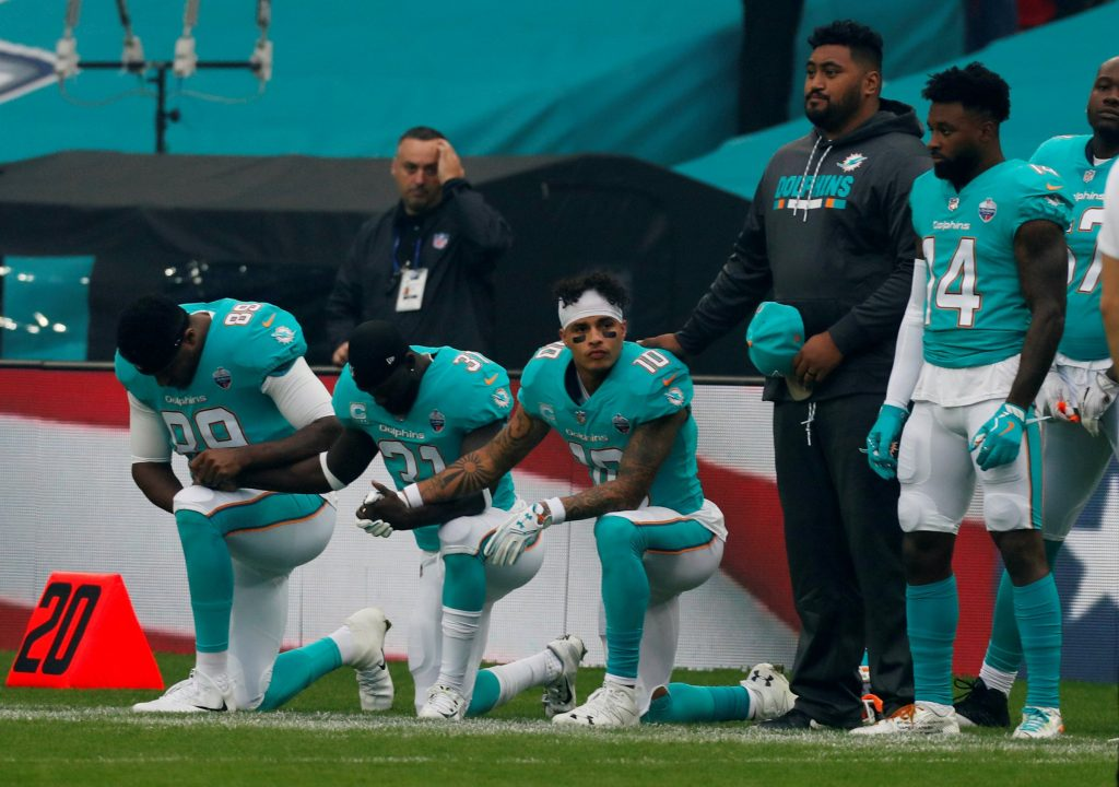 3 Miami Dolphins kneel during the national anthem while all Saints kneel before, but not during, after Trump warned players to stand