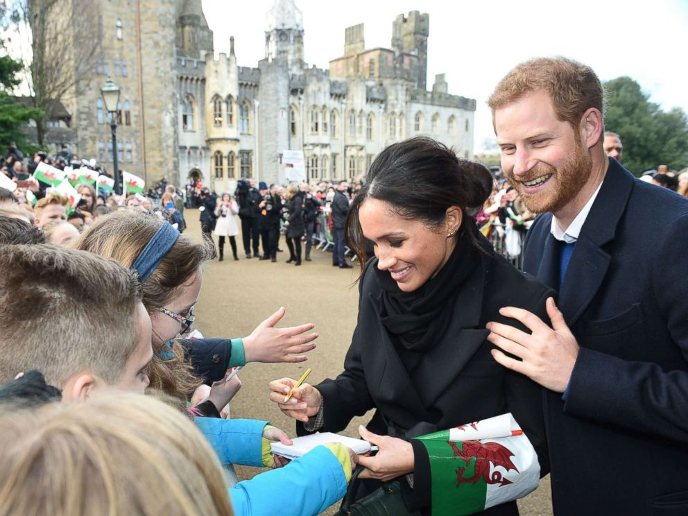 Meghan Markle and Prince Harry greeted by cheering fans in Wales