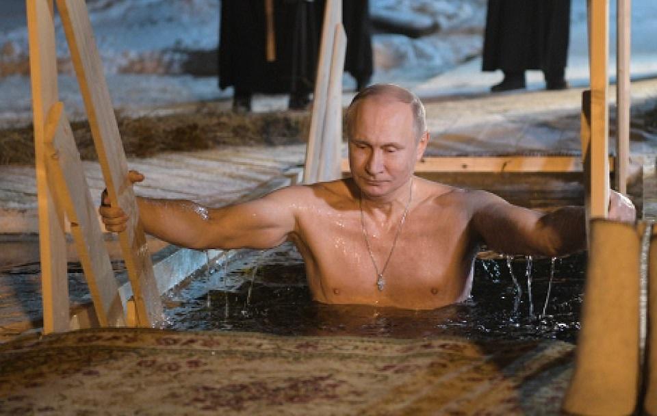 Russian President Vladimir Putin Dips Into Freezing Lake Seliger To Mark Epiphany