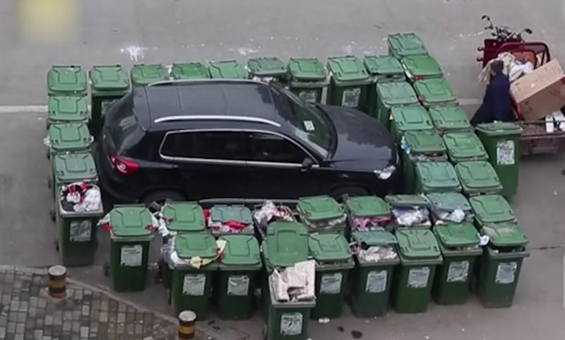 This Angry Chinese Cleaner barricaded illegally parked car with 40 rubbish bins