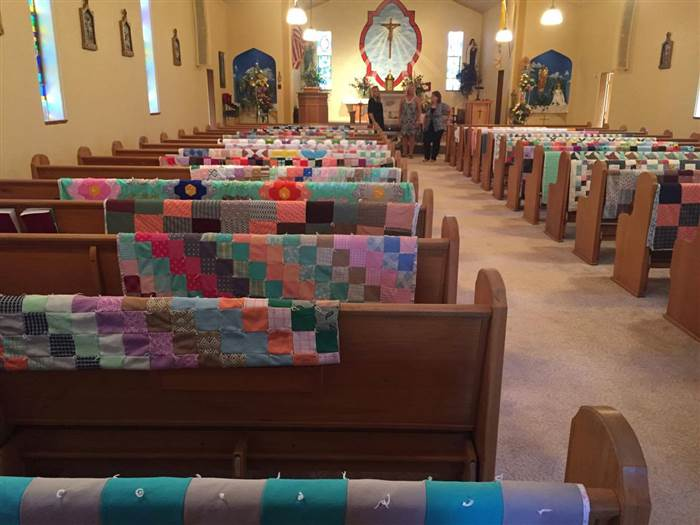 Family honors grandma's memory by displaying all of her quilts at her funeral