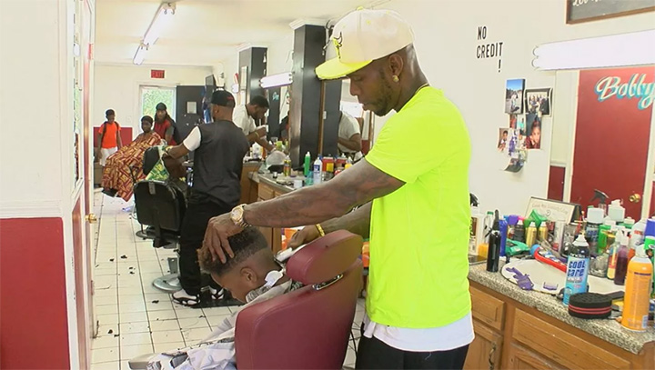 Barber gives free haircuts and backpacks to kids for their first day of school