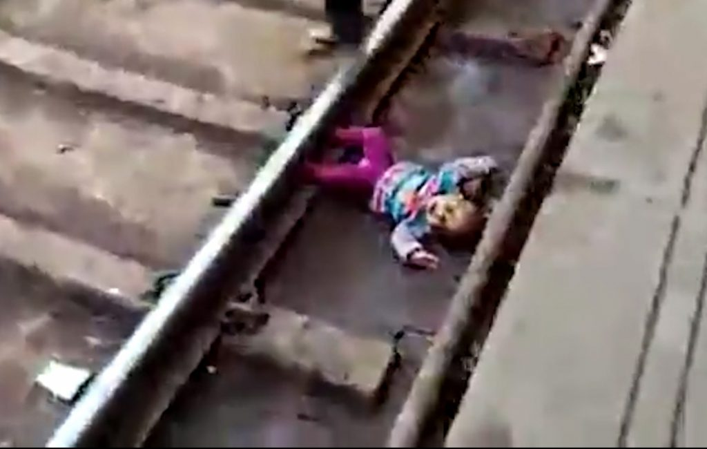 1-year-old girl survives after train passes over her