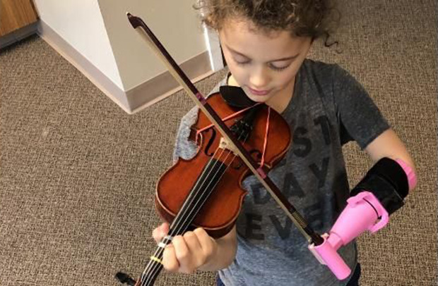 5-year-old girl with one hand plays violin thanks to biomedical engineering student's invention
