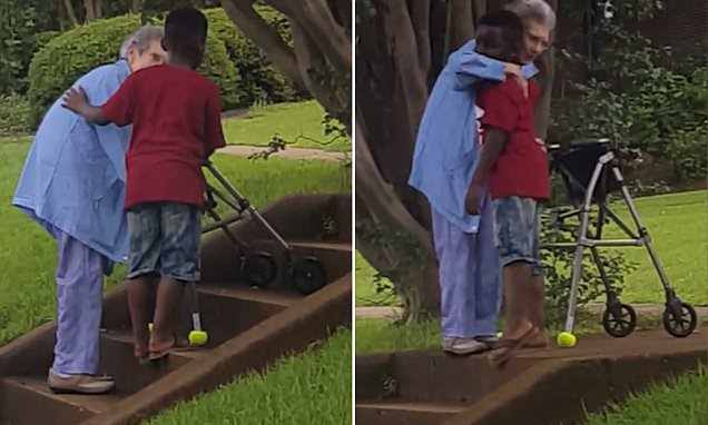 Special moment eight-year-old boy helps elderly woman struggling to walk up steps