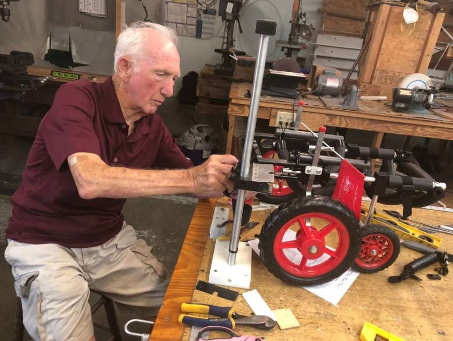 "92-year-old retired vet makes ""wheelchairs"" for paralyzed animals"