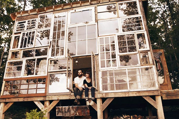 Artist couple build a cabin made of recycled windows (Video)