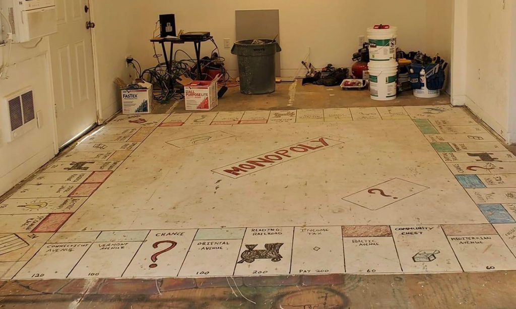 Homeowners Find Giant  Hand-Painted Monopoly Board  Under Their Carpet During Renovation