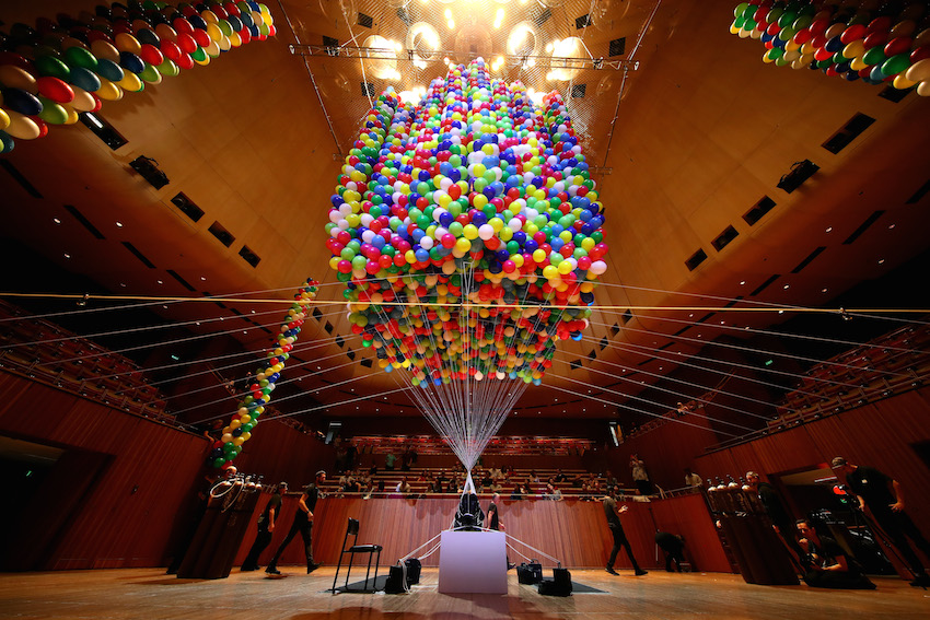 Disabled artist was lifted by 20,000 helium balloons for 9 hours inside the Sydney Opera House