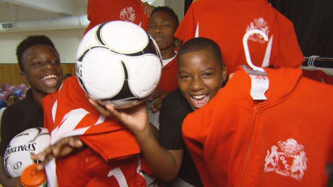 A Group Of Kids Surprised With New Soccer Uniforms And Equipment