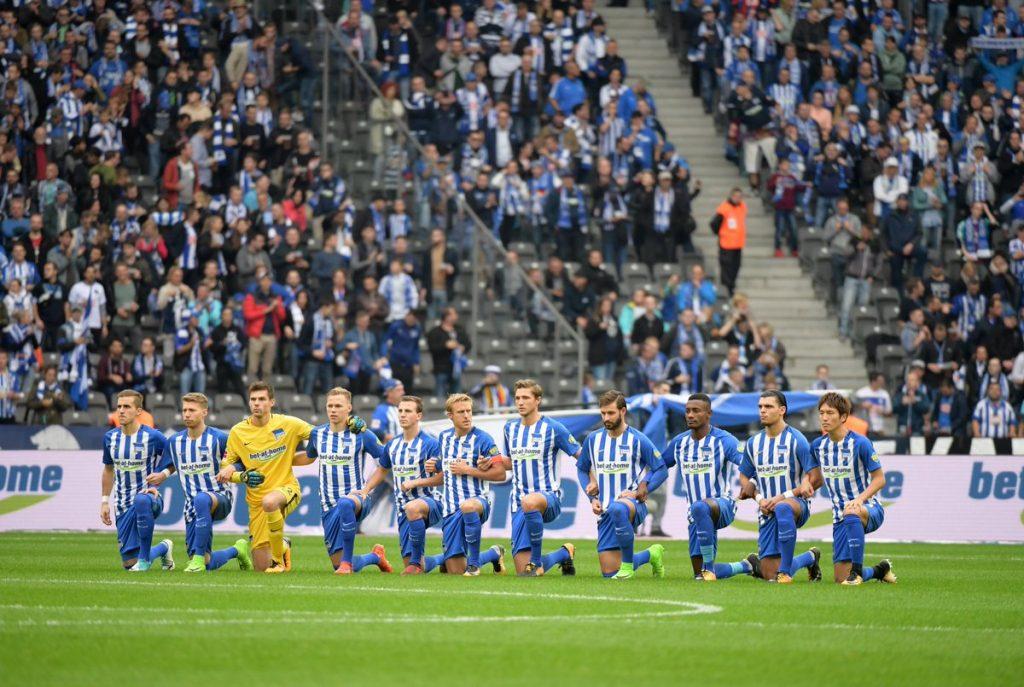 German soccer team Hertha Berlin takes a knee  before their Bundesliga contest