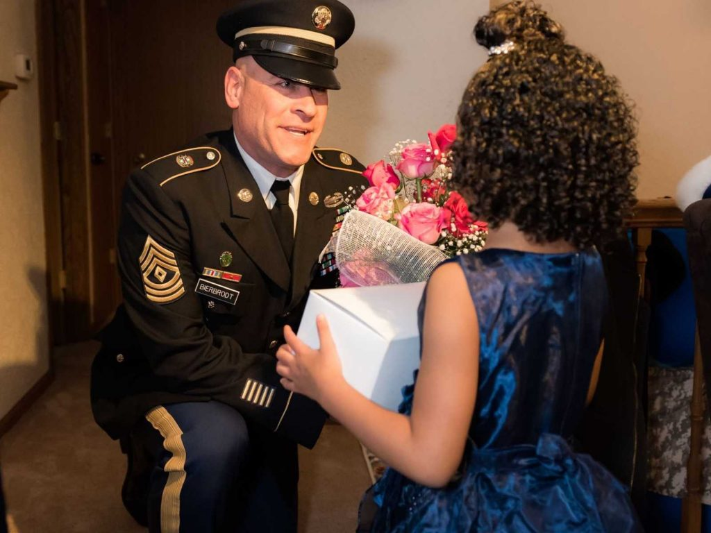 National Guard Soldier escorts kindergartner to daddy-daughter dance in her late father's absence