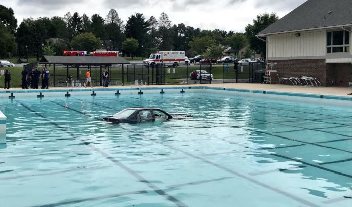 Driving lesson ends with car landing in a swimming pool